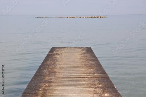 Plexiglas Pier wooden pier on the sea