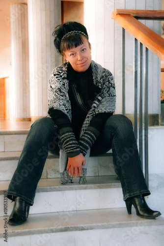 Woman on a marble staircase