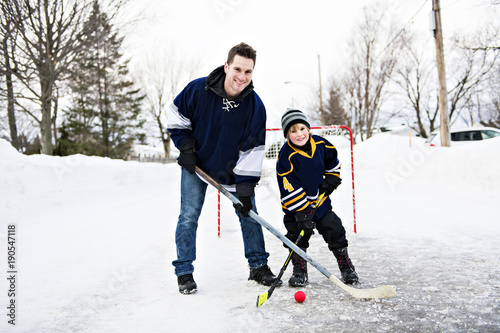 Father and son playing hockey