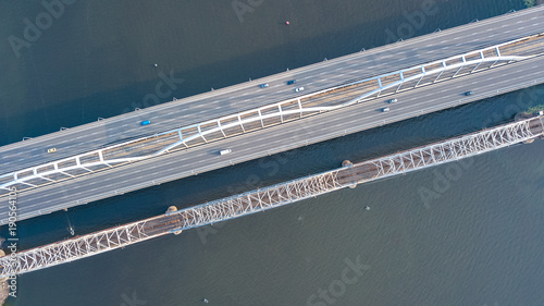 Aerial top view of bridge road automobile traffic of cars and railroad from above, transportation concept