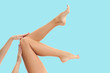 Woman's legs with smooth skin after depilation on pastel background.