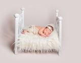 Lovely newborn baby on small crib - 190607318