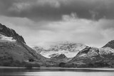 Beautiful  black and white Winter landscape image of Llyn Nantlle in Snowdonia National Park with snow capped mountains in background - 190608121