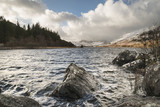 Beautiful Winter landscape image of Llynnau Mymbyr in Snowdonia National Park with snow capped mountains in background - 190608943