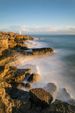 Beautiful vibrant sunset landscape image of Portland Bill rocks in Dorset England - 190609756