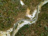 River and Snow in the Spruce Forest. Aerial View