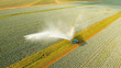 Aerial view: Irrigation equipment watering cabbage field. Irrigation system watering farm field. - 190624545