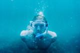 Male freediver swimming underwater. - 190632782