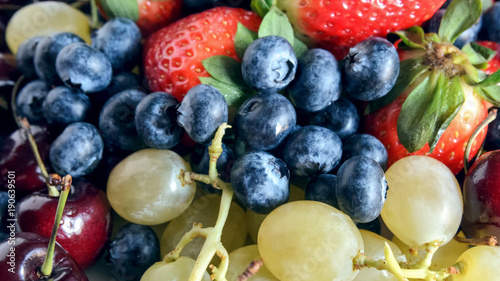 Fotobehang Kersen Mixed fruits large background. Variety fresh fruits: cherry, grapes, blueberry, strawberry. Healthy eating and raw diets concept.