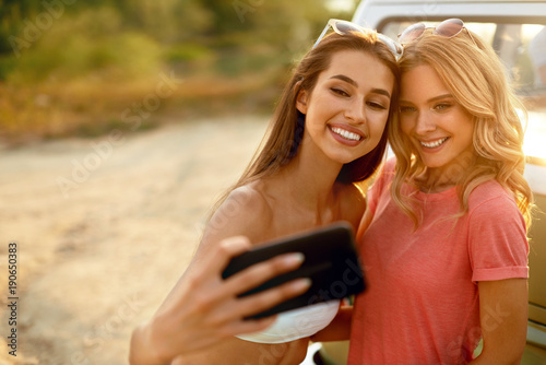 Happy Friends In Summer Having Fun, Taking Photos In Nature
