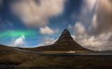 Aurora blasted in sky over Kirkjufell mountain at night, Iceland