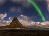 Aurora blasted in sky over Kirkjufell mountain at night, Iceland
