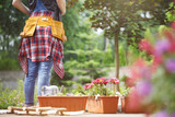 Professional gardener at work - 190657765