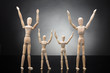 Wooden Figure Parents And Dummy Children Raising Their Arms - 190670134