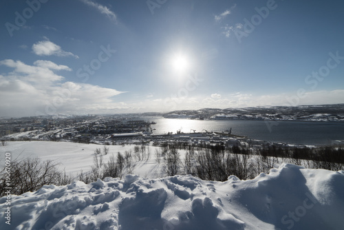 lake in the background of a snow-covered field on a sunny day © nelen.ru
