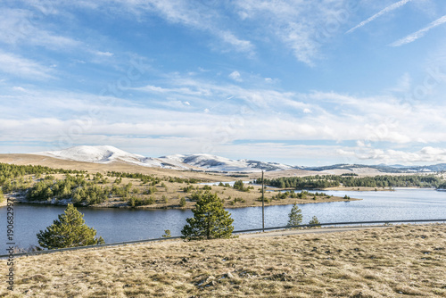 Fotobehang Beige nature landscape with snow mountain top and lake water