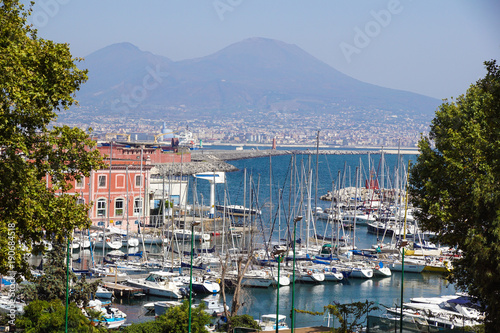 Aluminium Napels Napoli (Naples) and mount Vesuvius in the background at sunset in a summer day, Italy, Campania