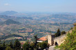 beautiful picturesque panoramic views of San Marino hills and old medieval stone castle wall with battlements