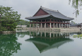 Small decorative palace, surrounded by water, and a reflection of the palace on the water, in  Gyeongbokgung Palace, Seoul, South Korea - 190687700