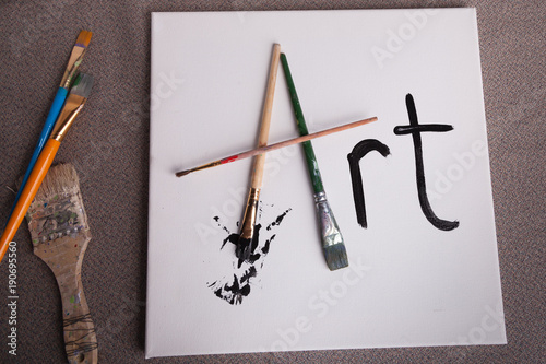 the word art written in paint brushes and paint