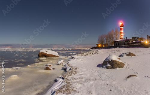 Fotobehang Vuurtoren Shepelevsky lighthouse in a moonlit night