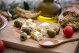 Greek cheese feta with virgin olive oil, green olives and fresh vegetables. - 190702359