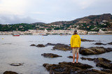 man looking at the small village of Port de la selva at sunset - 190704157