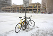 Bikes at snow downtown street