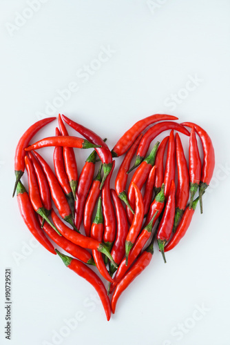 Foto op Aluminium Hot chili peppers heart from chili peppers
