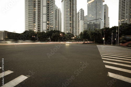 Foto op Canvas Shanghai Empty road surface with city landmark buildings of evening