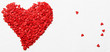 Red heart from sweet sugar hearts, Valentine's Day card, light background, top view