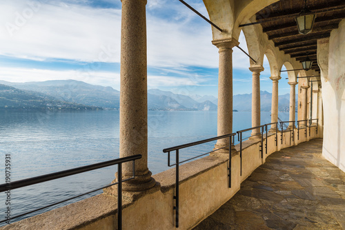 Colonnade of an ancient hermitage. Lake Maggiore from Hermitage of Santa Caterina del Sasso (XIII century), Italy, one of the most fascinating historical sites of Lake Maggiore, province of Varese