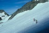NORTH CASCADES, WASHINGTON - AUG 20, 1975 -  Climbers traversing Mt Formidable,Ptarmigan traverse,North Cascades National Park, Washington - 190738369