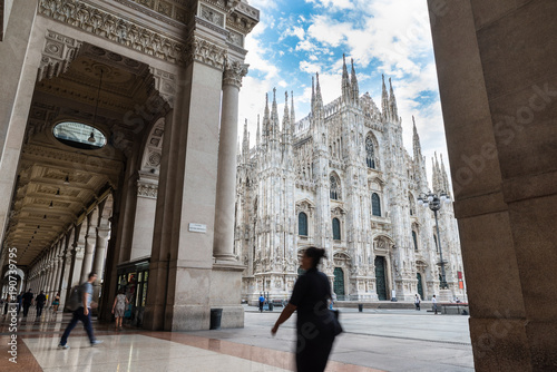 Milan Cathedral (Duomo di Milano) seen from the Vittorio Emanuele II Gallery; square Duomo in the city center of Milan, Italy