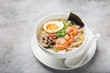 ramen noodle soup with prawn, shiitake mushroms and egg in white bowl
