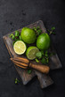 Quadro fresh green lime and mint on wooden cutting board