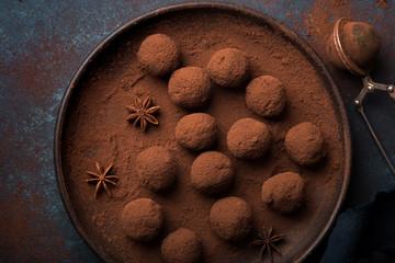 chocolate truffles on dark blue background