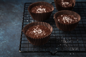 chocolate cups with salted caramel and nuts
