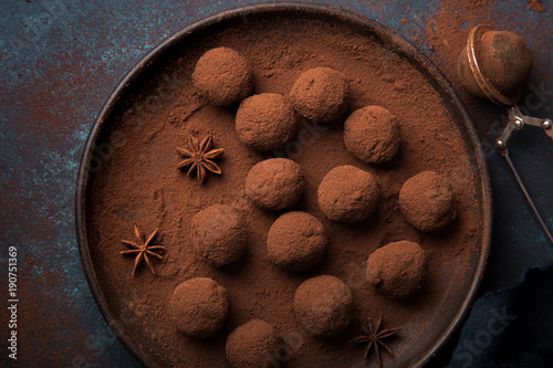 chocolate truffles on dark blue background