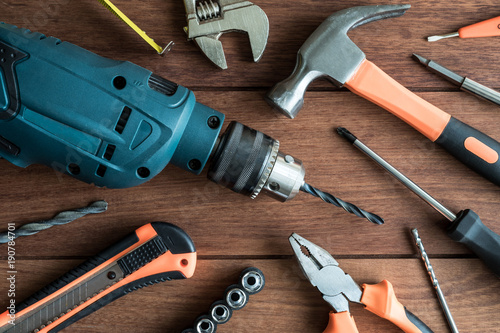 Foto Murales Set of work tools on wooden background