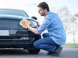 Man taking care and cleaning his car - 190787373