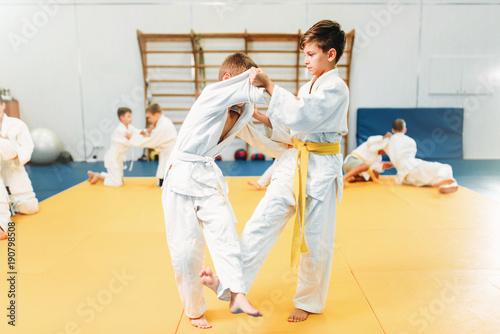 Boys in kimono fights, kid judo training