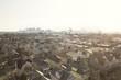 Dense Suburban Residential Neighborhood Aerial View with Boston City Skyline on Horizon