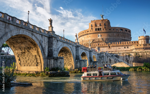 Papiers peints Rome Boat on the Tiber river near Sant Angelo bridge and castle in Rome, Italy