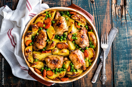 Chicken thighs baked with potato, carrot and green peas - 190821303