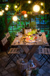 Preparation for dinner with snacks and wine in the garden - 190825773