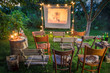 Summer cinema with retro projector in the garden