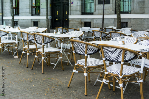 Foto op Canvas Madrid MADRID, SPAIN - April 20, 2017: Street view of a coffee terrace with tables and chairs in madrid