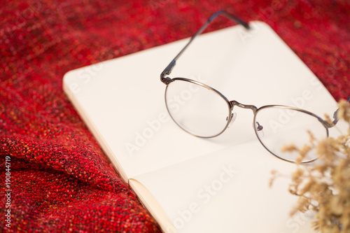 Foto op Canvas Herfst Closeup of book, glasses and autumn leaves, relax or other romantic concept
