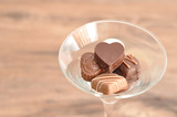 A variety of small chocolates displayed in a martini glass - 190846554